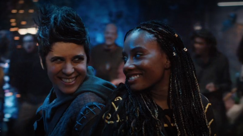 Mythic Quest queer gamers Rachel and Dana smile at each other while LARPing.