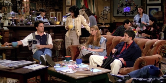 Monica, Phoebe, and Ross look at Chandler in the middle of the Central Perk coffee shop