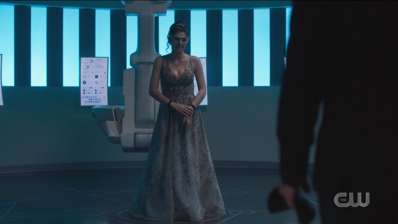Nia smiles nervously in the most stunning prom dress.