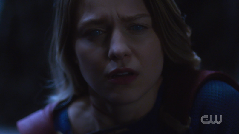 Supergirl Episode 607: Kara looks off into the middle distance with cloudy eyes, hopeless.