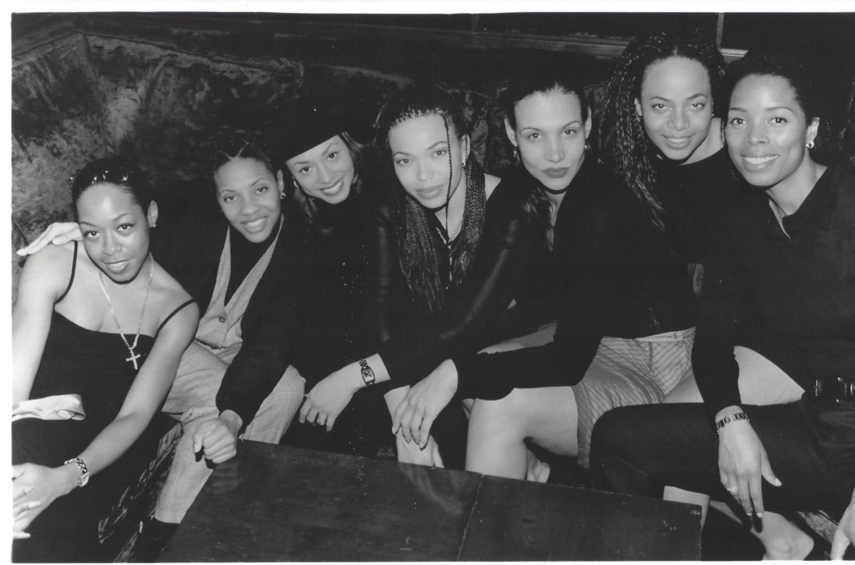 Image shows photo of 7 Black women and the photo is in black and white.