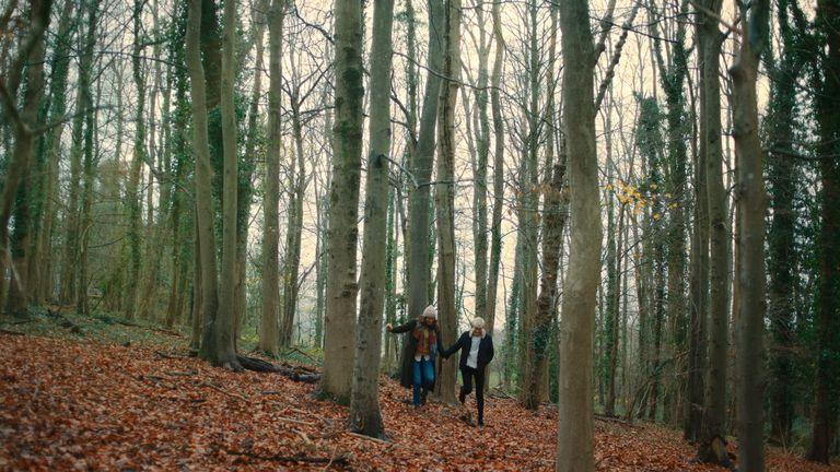 Mae and George on a hike in Feel Good season two