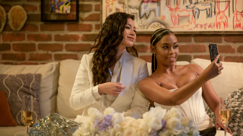 In Black Lightning, Grace and Anissa take a selfie together in matching white suits.
