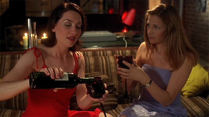 Helen pours a glass of wine for Jessica