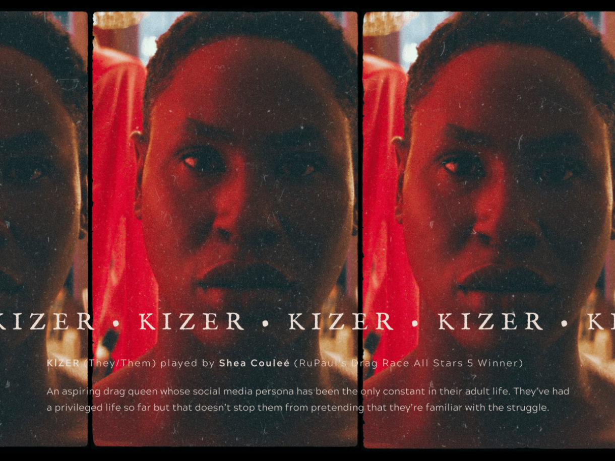 """Image shows a closeup of a beautiful Black person staring deep into the camera. A red light is behind them and their name """"Kizer"""" is across the screen."""