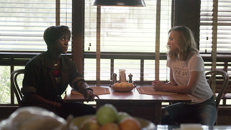 Carol and Maria sit at Maria's kitchen table.
