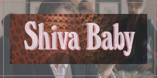 """Image shows pink text that reads """"Shiva Baby"""" overlaid on an image of a woman in a black and white suit holding a bagel smeared in cream cheese and smoked meats."""