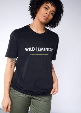 Model in a black t-shirt that says WILD FEMINIST in white lettering.