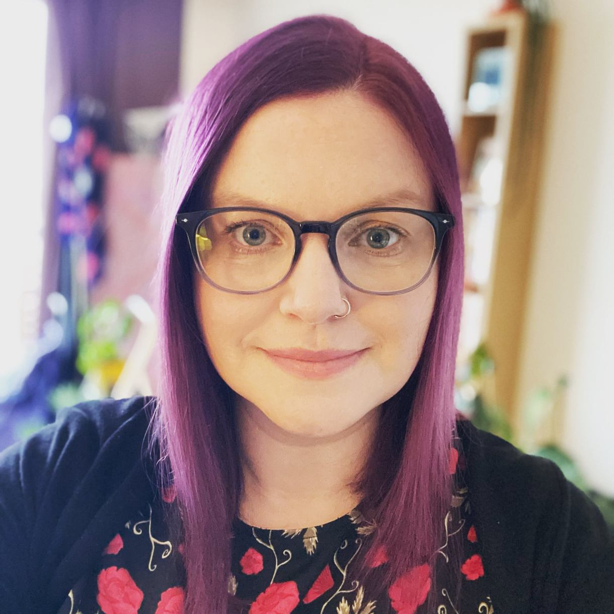 Ellie with purple hair and glasses in Paris