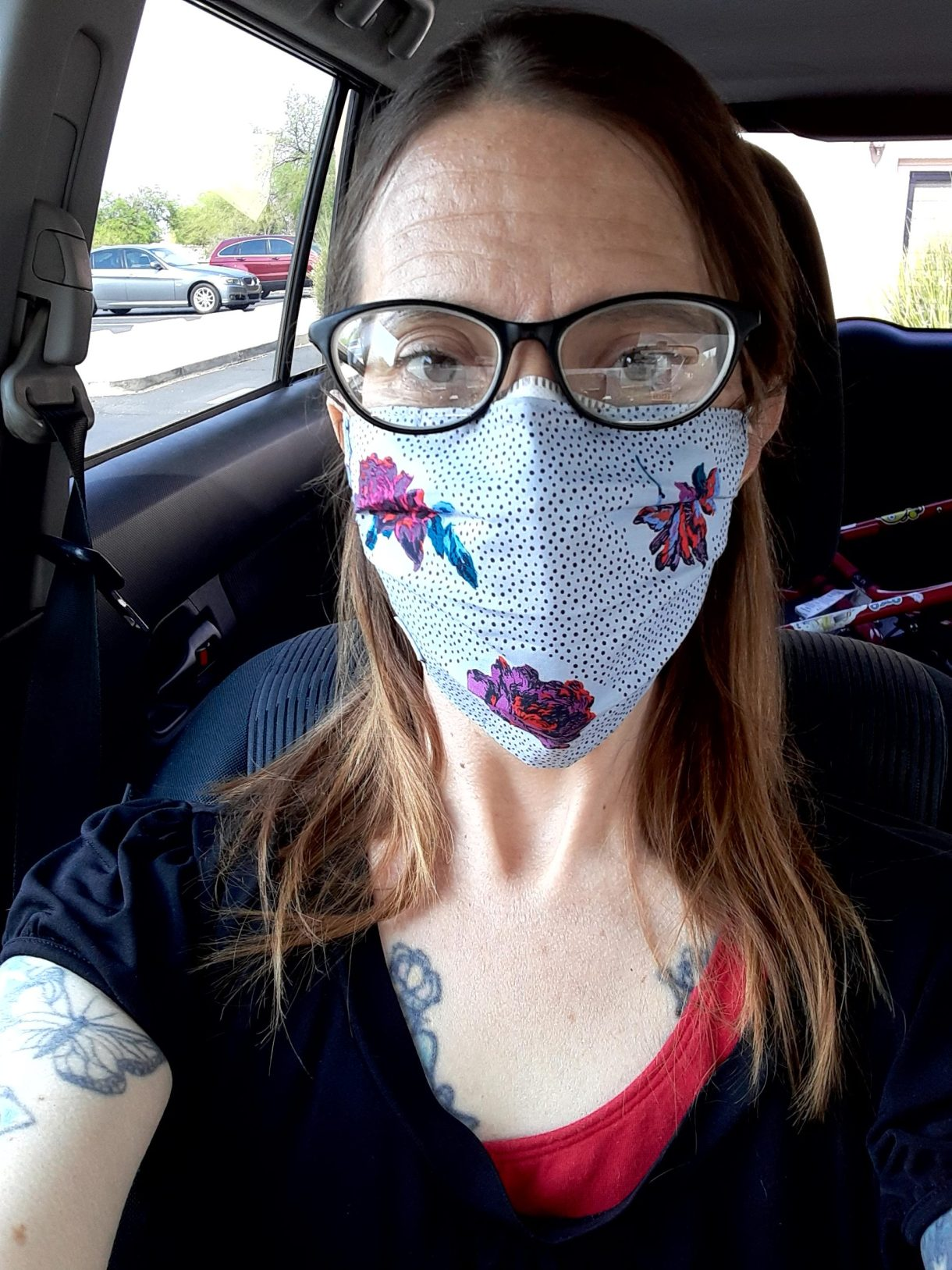 Tracy in a mask in her car