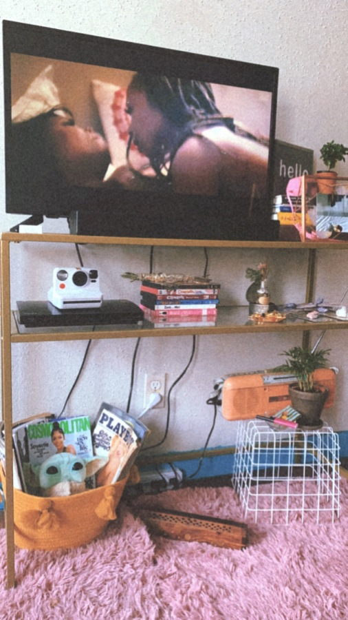 Shelli's TV set up featuring a scene of lesbian intimacy