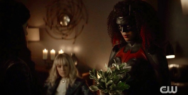 Batwoman presents the Desert Road plant, Alice is in the background