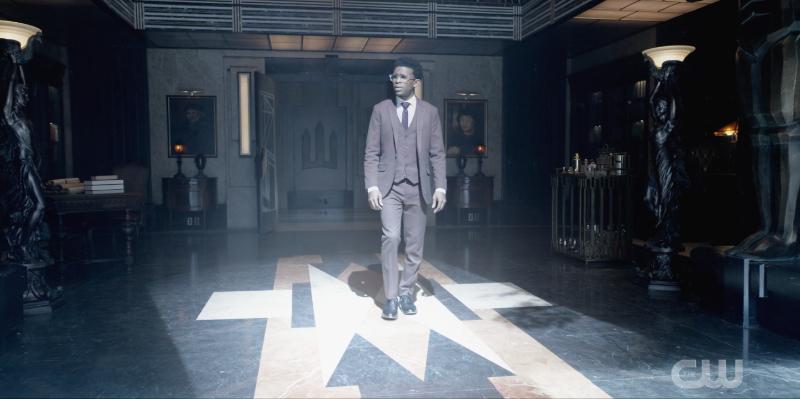 Luke Fox walking through Wayne Manor