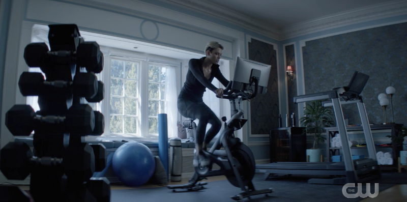 New Kate is riding on a exercise bike with a screen attached.