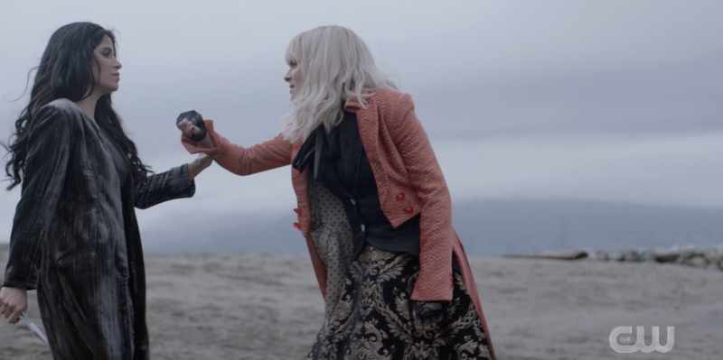 Alice and Safiyah fight on a beach