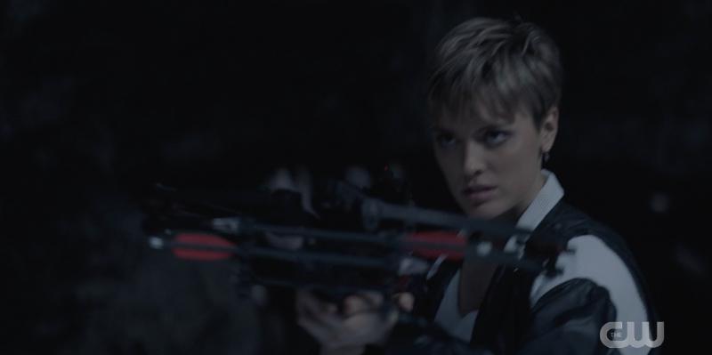 Wallis Day shoots a crossbow at night