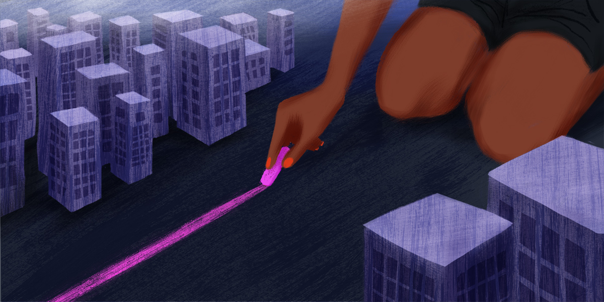 A Black figure wearing pink nail polish sits on their knees. On either side, there are small city buildings. The person is drawing a line down the middle of the city with pink chalk.