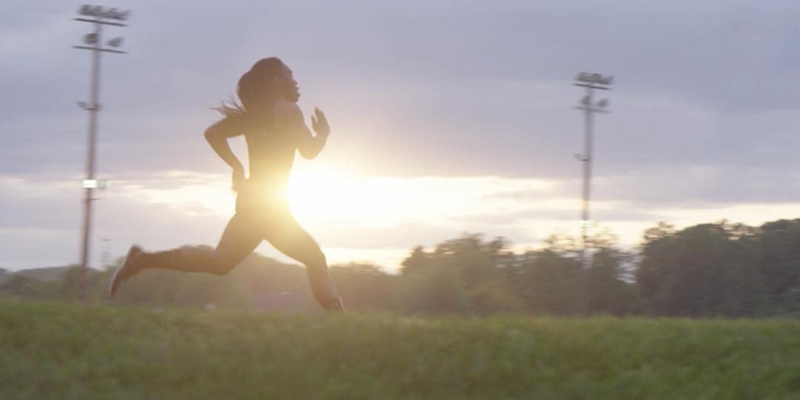In the documentary Changing the Game, a teenage athlete runs very fast against a blurred sunrise