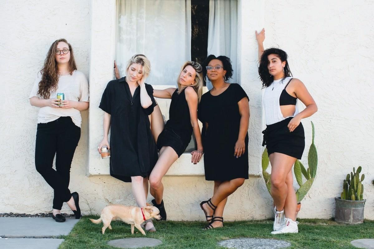 AS Senior Editors against a wall Rachel, Laneia, Riese, Carmen and Sarah. Also Carol the dog.