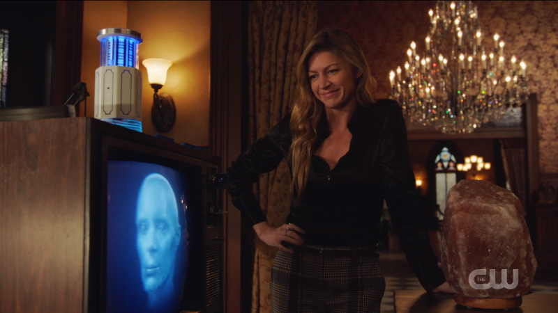 Ava has one hand on her hip and is smiling at Gideon and she's wearing a black silky button down and WHEW.