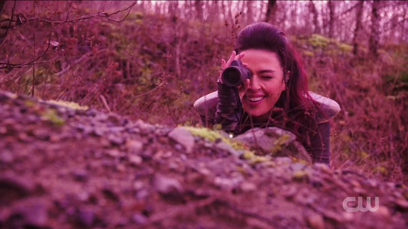 Legends of Tomorrow Episode 606: Aliyah O'Brien as Kayla looks through a lil telescope.
