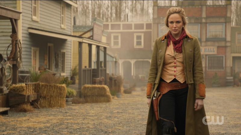 Legends of Tomorrow Episode 608: Sara walks coolly toward the shooting sheriff.