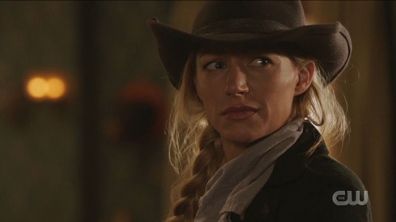 Ava looks concerned but sexy has hell in a cowboy hat.