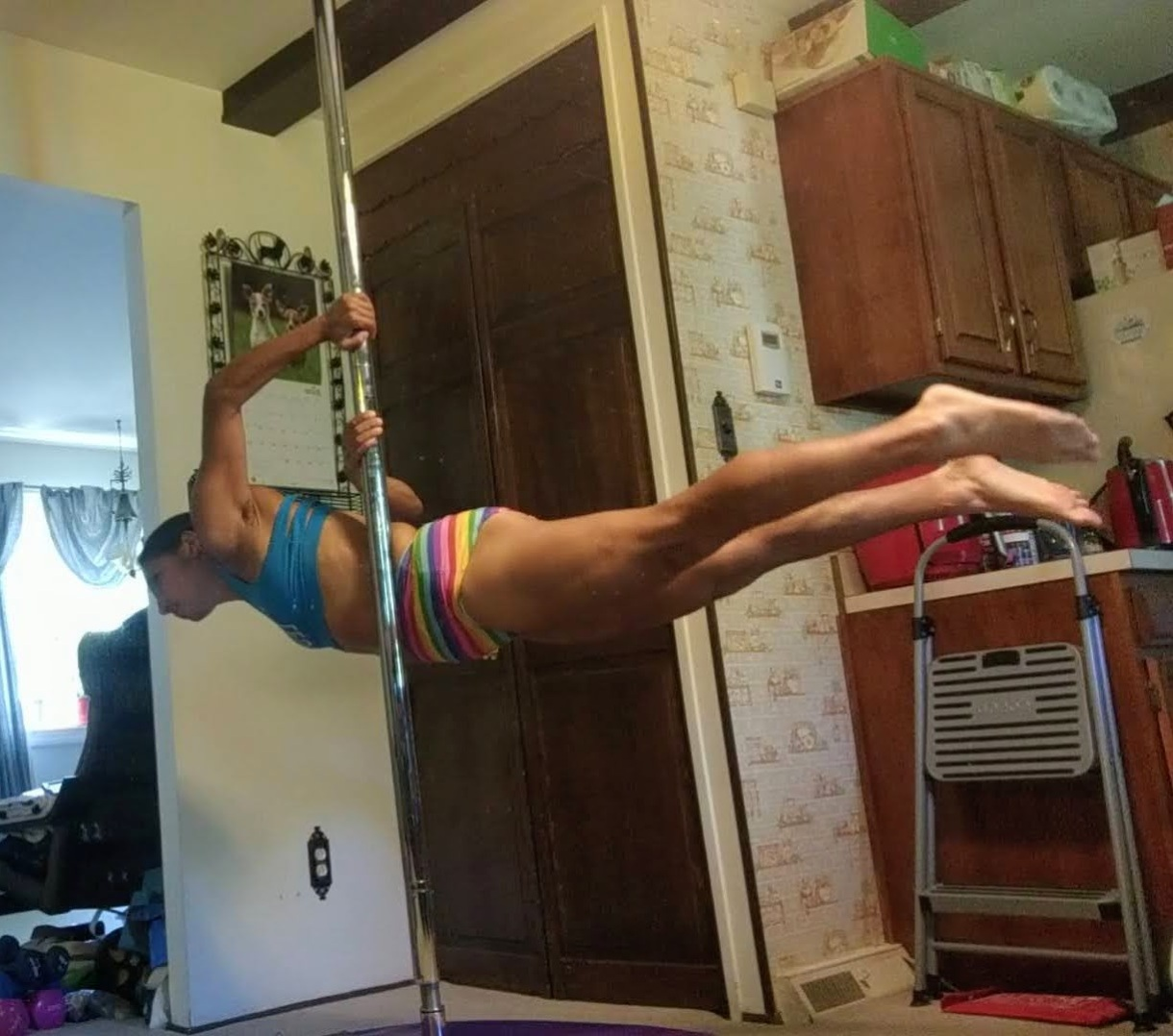 Erin pole dancing at home