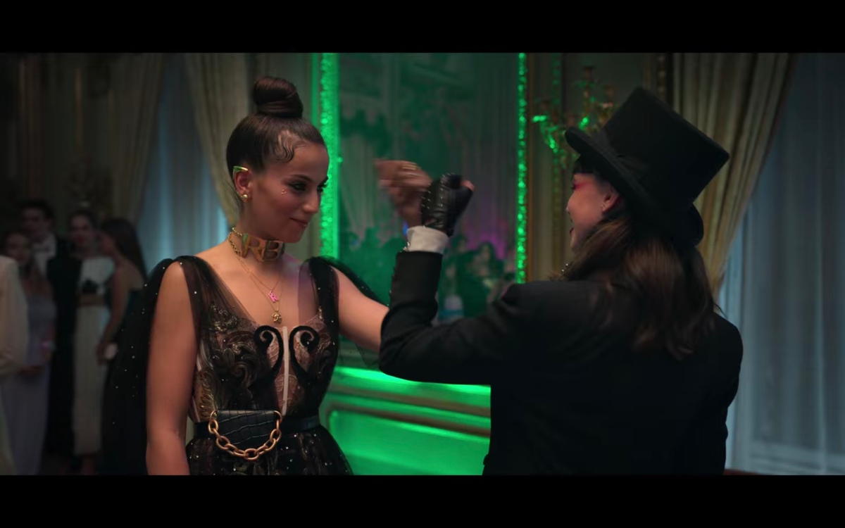 Rebe and Mencia do a fist bump at a costume party