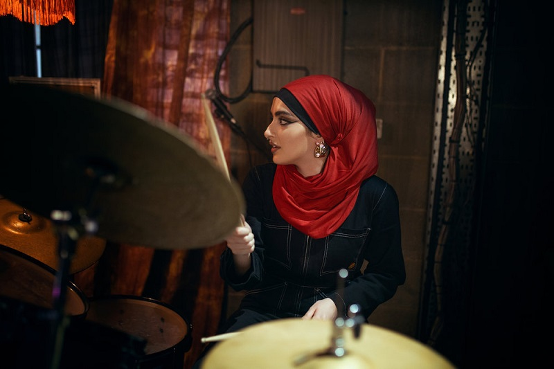 """Juliette Motamed as Ayesha, the Lady Parts' drummer, on the new show """"We Are Lady Parts."""""""