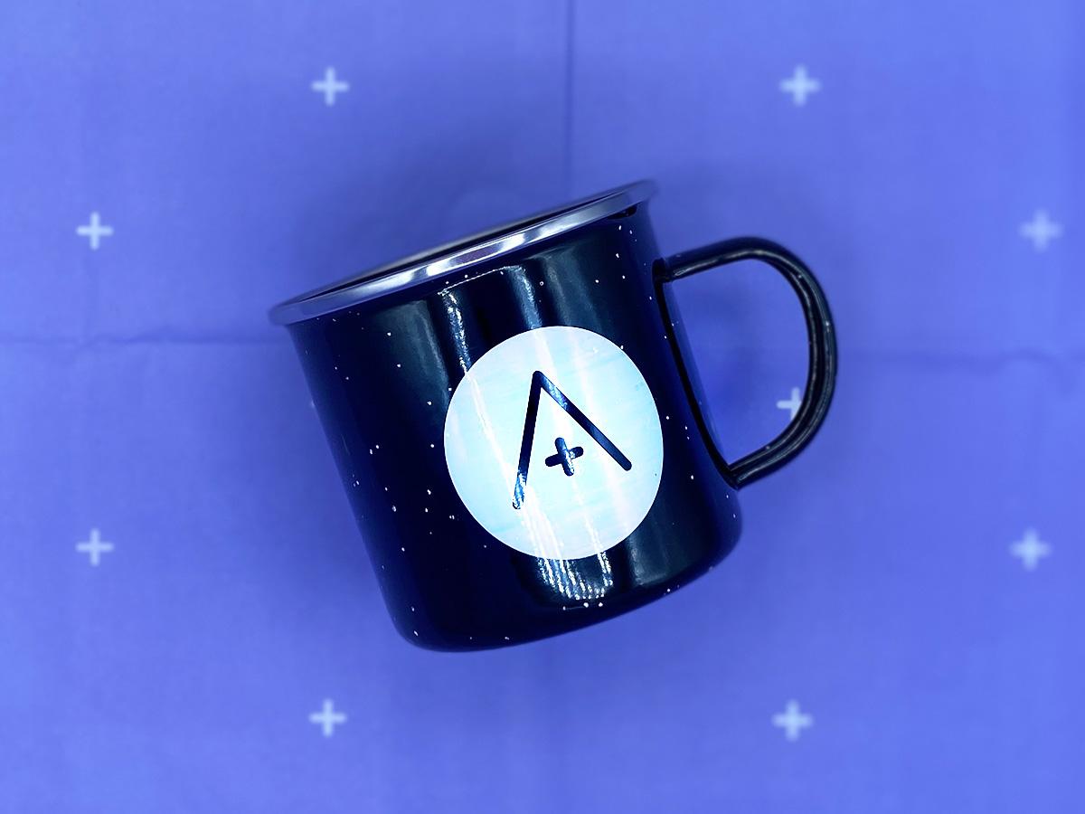 the a+ mug on a lilac background.