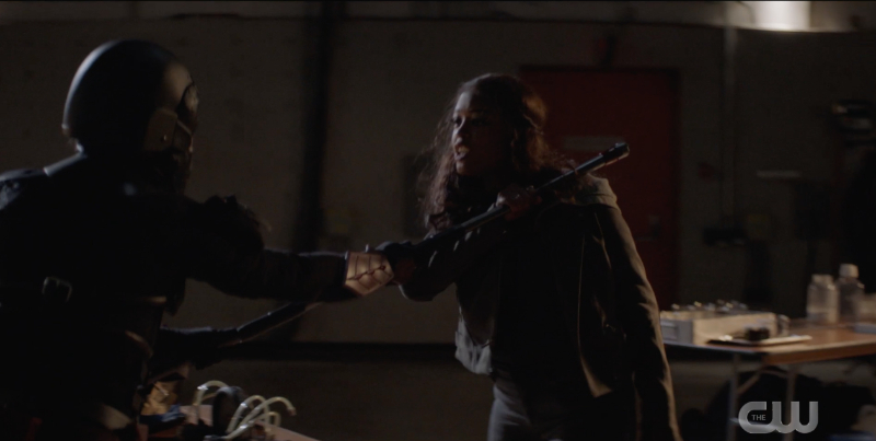 Ryan fights with her bo staff