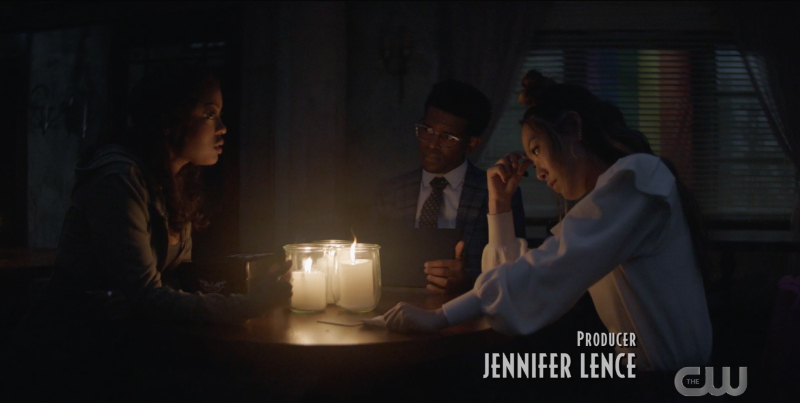 Mary, Luke, and Ryan sit at a table by candlelight, trying to make a plan