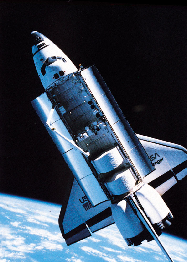 The challenger space shuttle orbiting above Earth