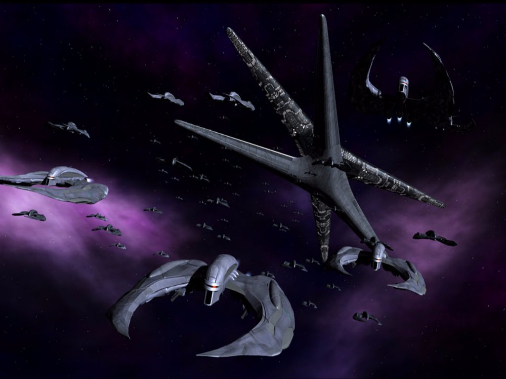 A fleet of really scary looking spaceships against a black and purple space backdrop