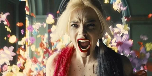 Harley Quinn, bisexual badass, screams as flowers explode around her.