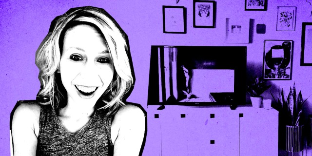 Riese is smiling, in high contrast in front of a background showing her TV and wall of art. the image is in black and white and purple.
