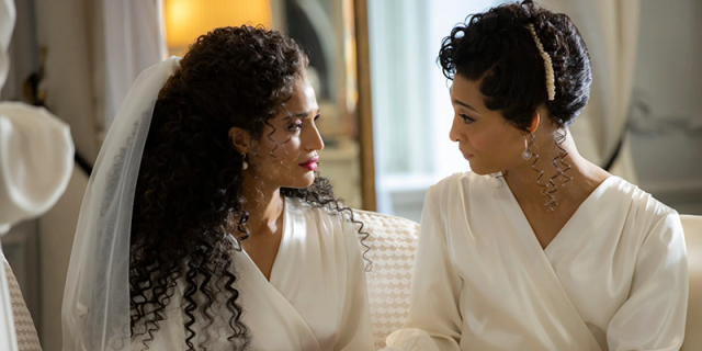MJ Rodriguez and Indya Moore in white wedding day outfits