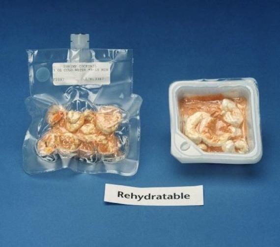Two plastic packages of freeze dried shrimp cocktail with a label saying rehydratable