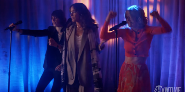 Shane, Alice, and Bette perform karaoke on stage during season two of The L Word: Generation Q