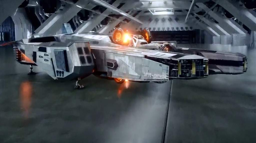 The Waverider time ship from Legends of Tomorrow docked in a huge hangar