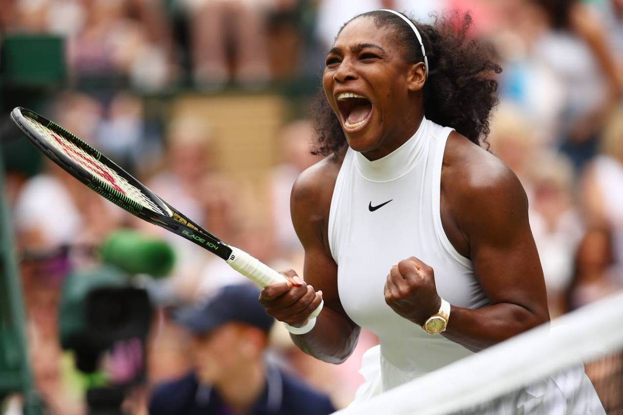 Serena Williams, the greatest athlete of all time, pumping both fists and crying out after a victorious point