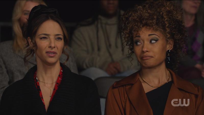Zari looks offended, Astra looks amused