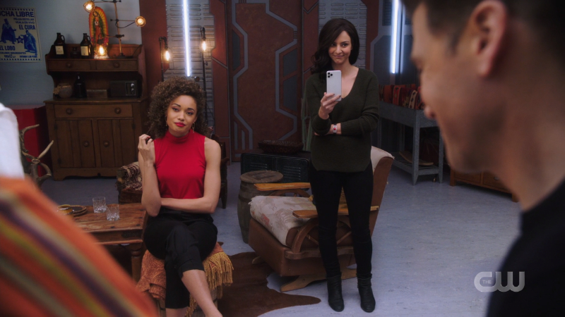 Astra and Original Zari look amused by the boys' antics; Zari is filming it on her phone.