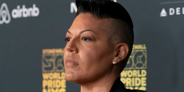 A close up of Sara Ramirez looking very handsome with a strong jawline