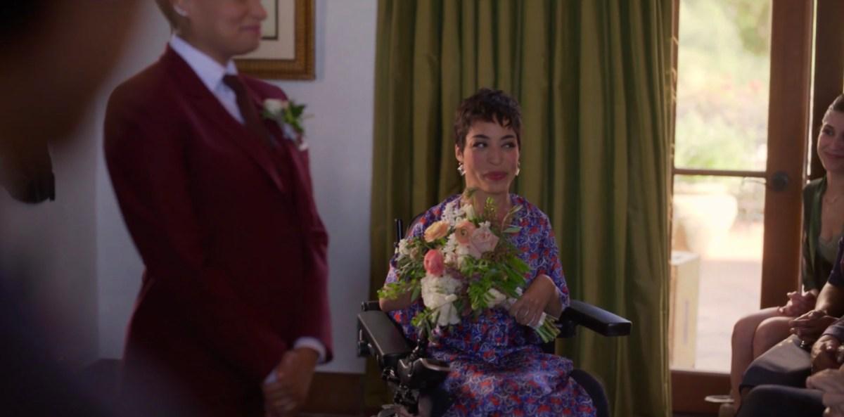 Maribel with flowers in the wedding room