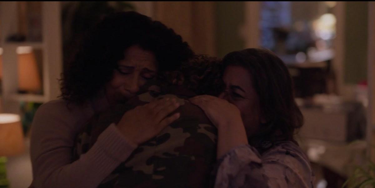 sophie hugs her family