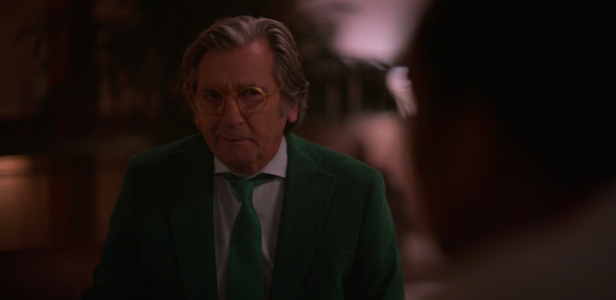 Issac in a green suit