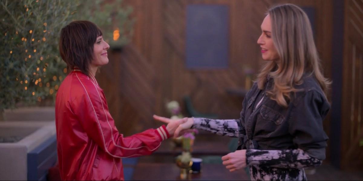Tess holding onto Shane's wrist