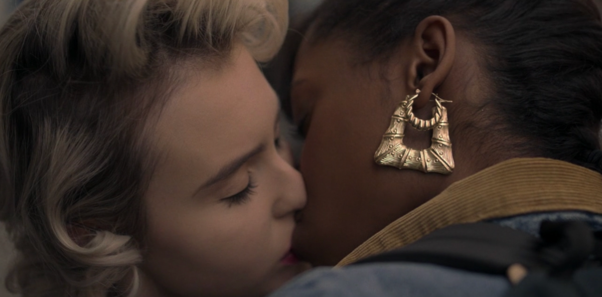 Jukebox and Nicole are in the middle of a close up kiss